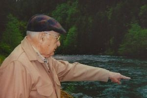 Dad pointing out fish on the North Umpqua in 1999, shortly after Mom's death
