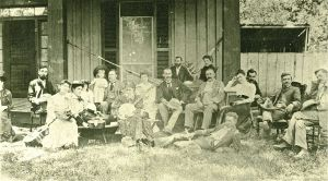 A potlatch party at Fort Simcoe on July 4, 1894 - HJ is in the chair behind the man lying down and Lizzie is behind