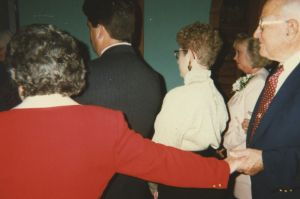 Eileen reach for Henry at a family wedding in 1996
